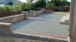 Spartan Landscaping LLC brick patio pavers with wall and arches