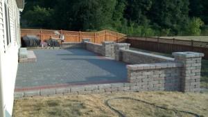 Brick Paver Deck w/ Wall - Spartan Landscaping LLC
